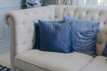 34872356 - blue pillows on white sofa in luxury living room